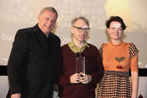 Todd Solondz gets the Indie Star award from festival director Roman Gutek and programme director Urszula Sniegowska